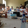 Traveling participants eat a meal together at St. Matthew's.