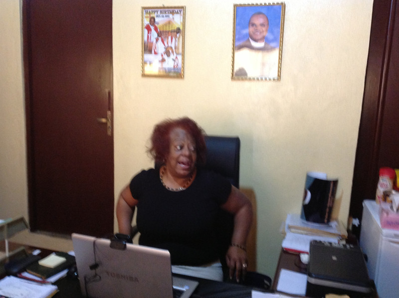 Pastor Patricia Davenport in Bishop Jensen Seyenkulo's office.