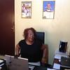 Pastor Patricia Davenport in Bishop Jensen Seyenkulo's office.