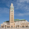 "<h2>Hassan II Mosque</h2><h3>Casablanca, Morocco</h3> The great Hassan II Mosque was commissioned by its namesake, King Hassan II, in part to provide Casablanca with a single landmark monument. On his birthday, July 9, 1980, the king declared:<br><br>""I wish Casablanca to be endowed with a large, fine building of which it can be proud until the end of time... I want to build this mosque on the water, because God's throne is on the water. Therefore, the faithful who go there to pray, to praise the creator on firm soil, can contemplate God's sky and ocean.""<br><br>Designed by French architect Michel Pinseau, construction of the Hassan II Mosque began in July 1986 on land reclaimed (without compensation to the former residents) from a run-down area near the sea. The goal for completion of the mosque was King Hassan II's 60th birthday in 1989, but it ended up not being finished until August 30, 1993.   The project is estimated to have cost as much as $800 million, funds that were remarkably raised entirely from public subscription.   International reports have suggested both local resentment and less-than-voluntary donations to the project, but Moroccans seem to be genuinely proud of their monument and pictures of the mosque are displayed in homes and cafes throughout the country. The massive fundraising also had a positive side-effect: it temporarily reduced Morocco's money supply and brought down inflation.   Nearly all the materials of the Hassan II Mosque are from Morocco, with the sole exceptions of the imported white granite columns and glass chandeliers (from Murano, near Venice). The marble is from Agandir, the cedar wood is from the Middle Atlas and the granite comes from Tafraoute.   Over 6,000 Moroccan master craftsmen and artisans were employed to work these local materials into the dazzlingly intricate decorations that embellish the entire structure. When construction passed its deadline in the early 1990s, 1,400 men worked by day and 1,000 worked by night to bring the vast project to completion."