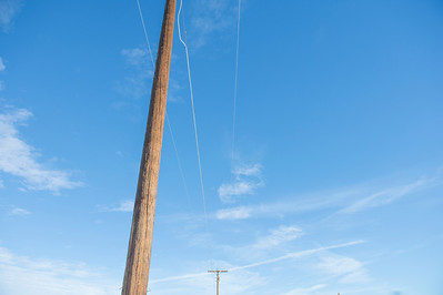 Old Telephone Poles against a Bright Blue Sky
