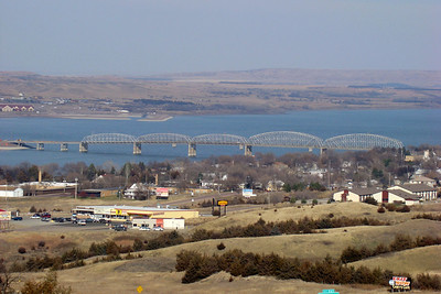 November 28, 2009, 12:25 PM: The city of Chamberlain, SD sits on the bank of the Missouri River (here a wide spot named Lake Francis Case), with two highway bridges and a railroad bridge all providing access to the far side.