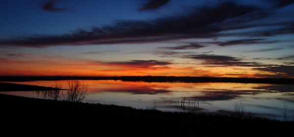 November 27, 2009, 5:30 PM: This lake about 6 1/2 miles south of Redfield, SD provided us with a reflection of the beautiful sunset.  Must have spent nearly half an hour there, shooting photo after photo with all 3 cameras.