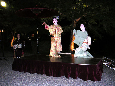 Geishas dancing for us.