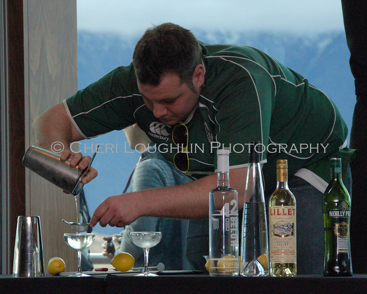 Aaron mixing cocktail at summit
