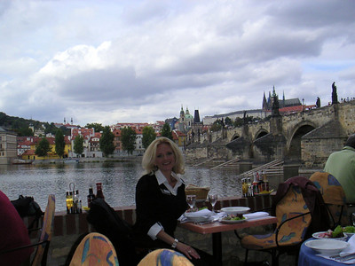 Brooke in the outdoor restaurant overlooking the Vltava River and the Charles Bridge in Prague, Czech Republic.  The bridge has been closed to all but walking traffic.  Probably can't handle it anymore.  FYI:  The Czech Republic used to be Czechoslovakia, but after the Soviet Union dissolved, they split into two, The Czech Republic and Slovakia.  The end of Communist rule in Czechoslovakia in 1989, during the peaceful Velvet Revolution, was followed by the country's dissolution, into two states. The Czech Republic and Slovakia went their separate ways after January 1, 1993, an event sometimes called the Velvet Divorce, but Slovakia has remained a close partner with the Czech Republic