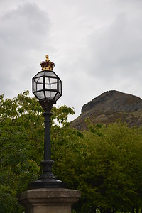 A lamppost near the entrance of Holyrood Park with Arthur's Seat in the background.