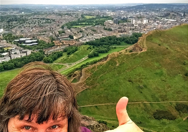 My gray hair was happy to be at the top of Arthur's Seat with the Salisbury Crags somewhat far below me.
