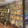 Looking into a small grocery shop, we can see an amazing display of hams.