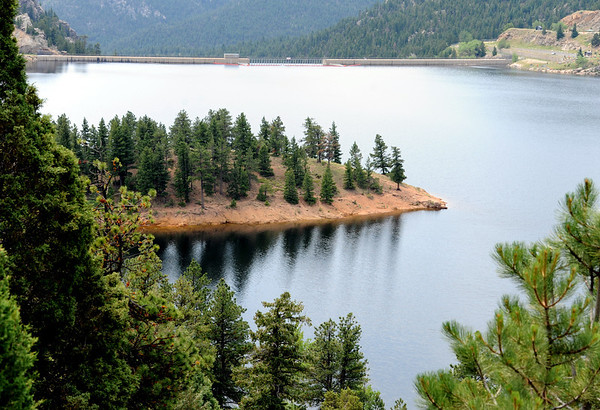 Trees reflect in the water of Gross Reservoir on Wednesday.<br /> Cliff Grassmick / July 6, 2011