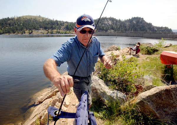 Doug Greenfield and his wife, Candy,  of Aurora, have been fishing at Gross Reservoir for over 30-years.<br /> A handfull of fishermen had a quiet day at Gross Reservoir on Wednesday.<br /> Cliff Grassmick / July 6, 2011