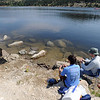 Jeremy Jams, left, and Roland Mombelli, fish at Gross Reservoir on Wednesday. <br /> A handfull of fishermen had a quiet day at Gross Reservoir on Wednesday.<br /> Cliff Grassmick / July 6, 2011