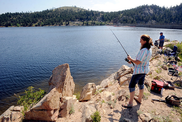 Candy Greenfield and her husband, Doug, of Aurora, have been fishing at Gross Reservoir for over 30-years.<br /> A handfull of fishermen had a quiet day at Gross Reservoir on Wednesday.<br /> Cliff Grassmick / July 6, 2011