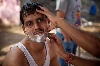 A barber, Dharavi.