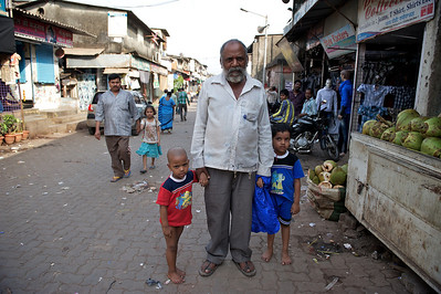 Father and his two sons, Dharavi.