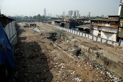 Recently cleared area around water pipes, Dharavi.