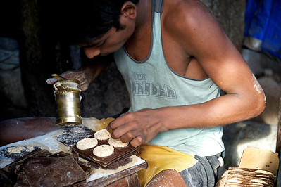 Cookie maker, Dharavi.