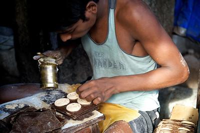 Cookie maker, Dharavi.