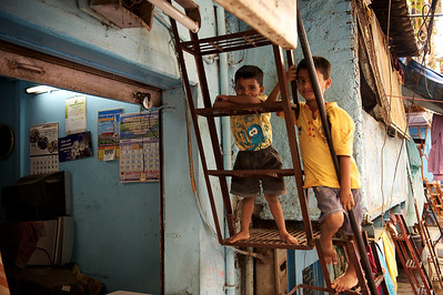 Boys watching TV in a TV repair shop, Dharavi.