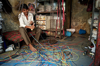 Recycling copper wire, Dharavi.