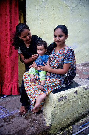 Young girl and her baby niece, behind Mariott hotel, near Powai lake.