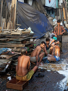 Men washing in the street, Dharavi.