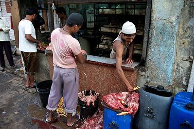 Chicken butcher, Dharavi.