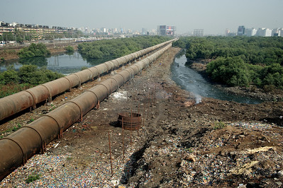 Aquaduct and train line cutting through Dharavi.