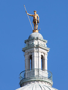 """... capped by a golden sculpture of the """"Independent Man""""."""