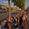 Watching the ceremonies. The absence of traffic on the Champs Elysee was an unusual sight.