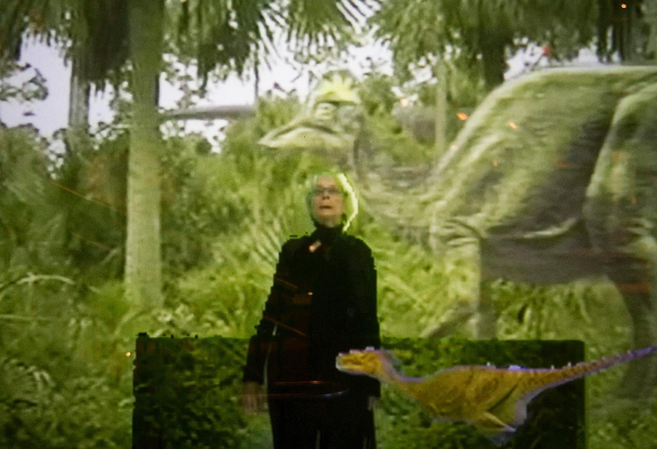 Carol in dinosaur jungle projection