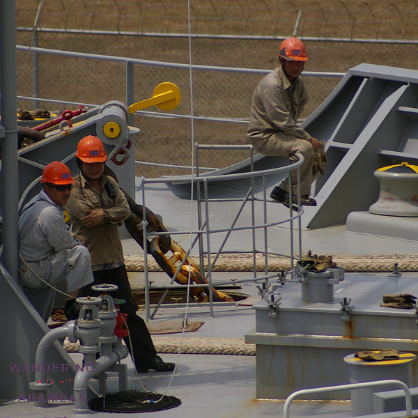 Deck hands, awaiting the next move as they pass through the Panama Canal