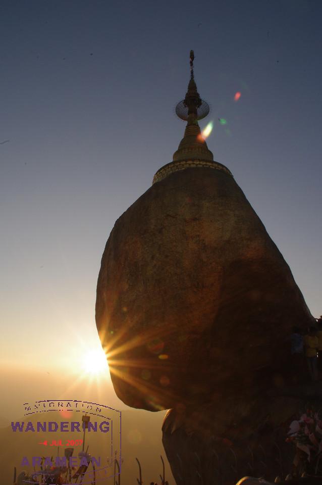 The sun setting behind Mt. Kyaiktiyo