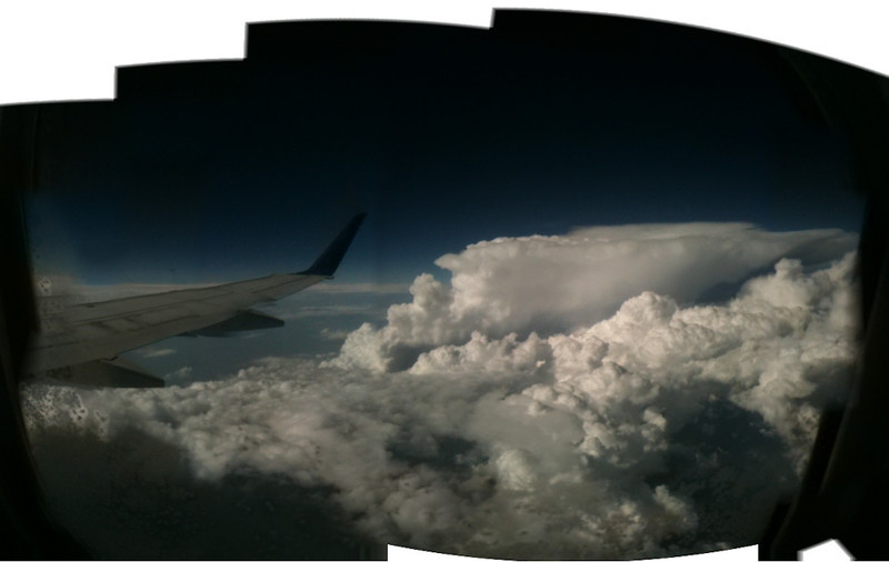 Storm off to the north, flying from Grand Rapids to Denver