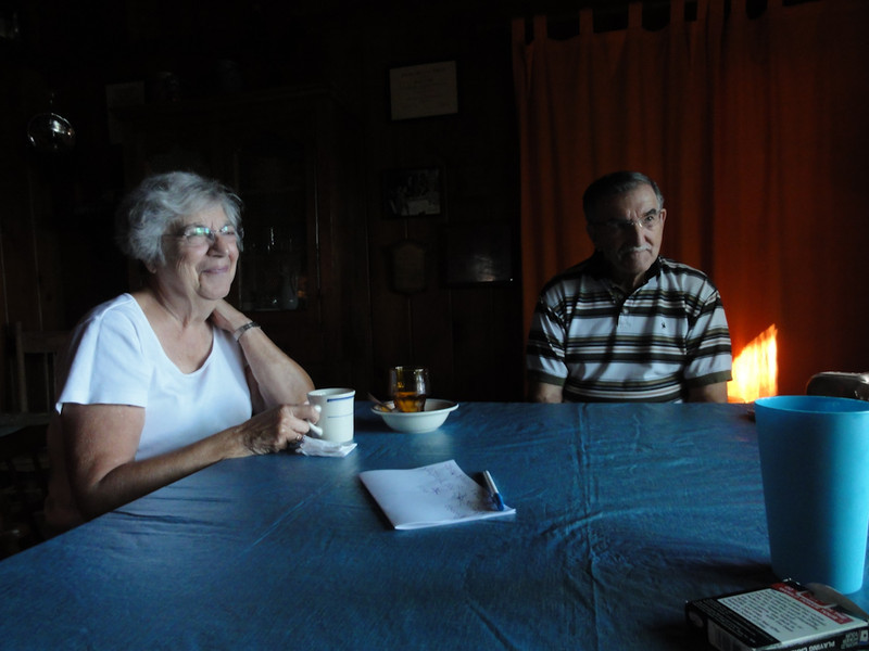 The Peponis' at the dining table in the cabin, Big Twin, Michigan