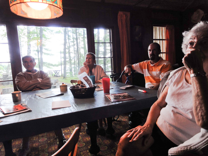 Family @ the dining table in the cabin, Big Twin, Michigan