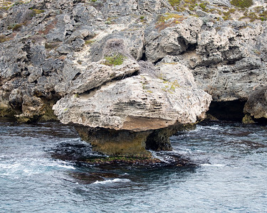 An Osprey nest adorns this wind-and-water-carved rock.