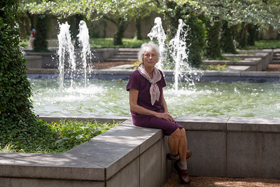 Carol enjoys the Art Institute fountain as we wait to go in.