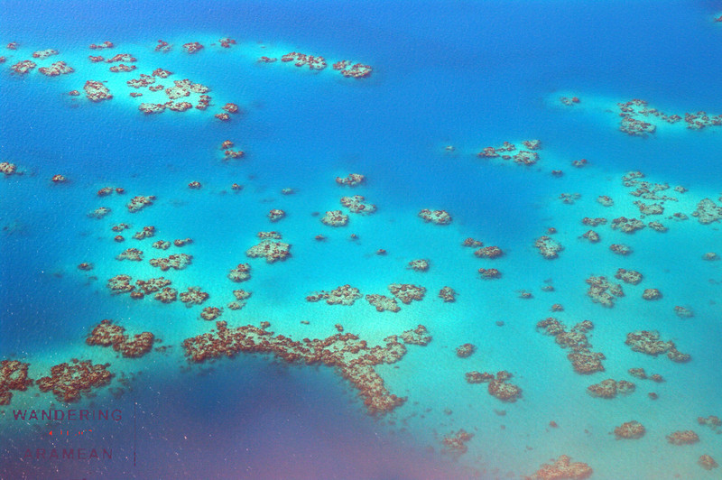 Looking down on the atolls  surrounding Bermuda on final approach