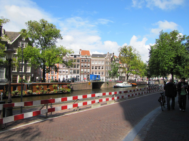 """41-Houseboats in the Prinsengracht at Bloemgracht (""""Flower ditch"""") across from the Anne Frank House."""