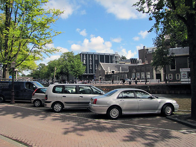 32-Anne Frank Museum, left; West Church (Westerkerk) on right