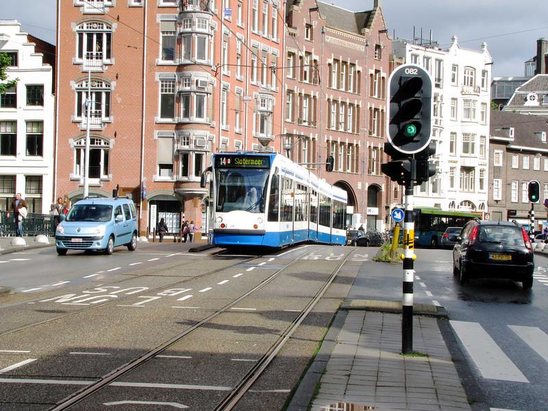 "46-Waiting for tram, Radhuisstraat (""Town hall street"") bridge at Keizersgracht (""Emperor's ditch"")"