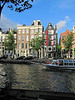 08-Canal bus plies Prinsengracht. Route and stops are marked on the hull.