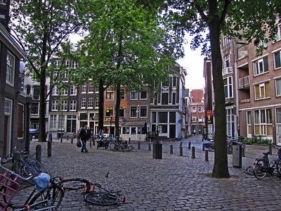 "06-At the base of the Old Church stepple is Old Church Square (Oude Kerk's Plein) and the Red Light district. See neon sign ""Sexy Land,"" right middle-ground."