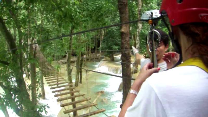DJuna zip lining over water in Laos.