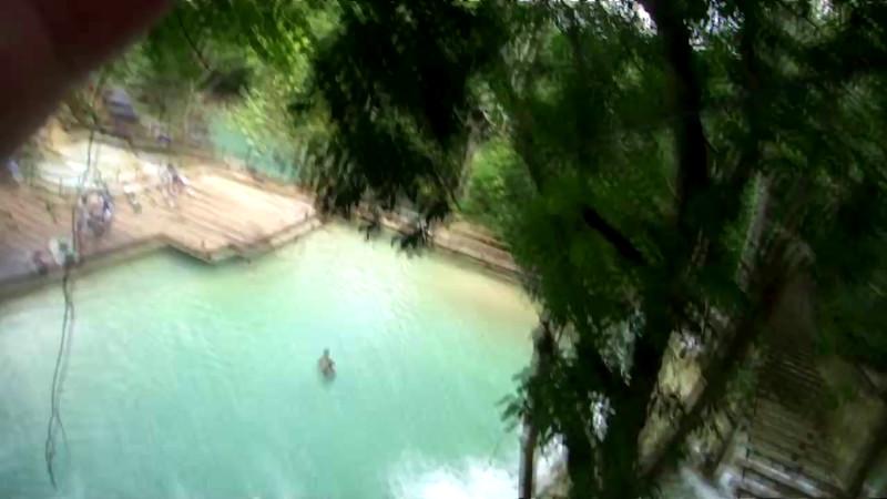 Ralph zip lines over water in Laos.