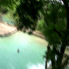 Ralph zip lines over water in Laos.