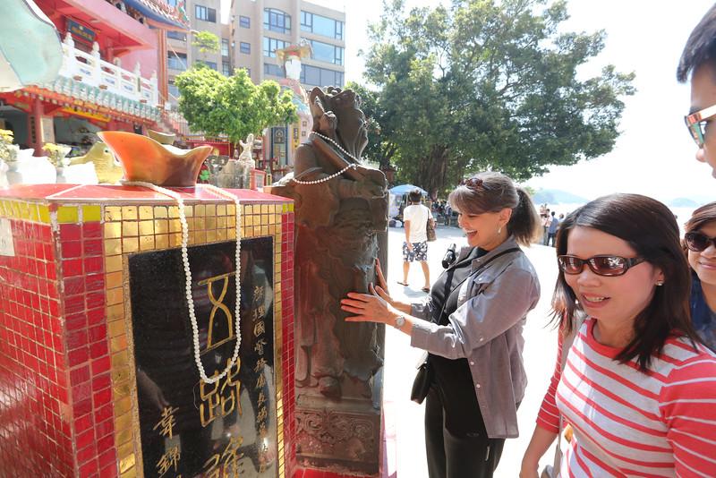 Hong Kong - Welcome to Repulse Bay Beach.<br /> Julie making a wish.