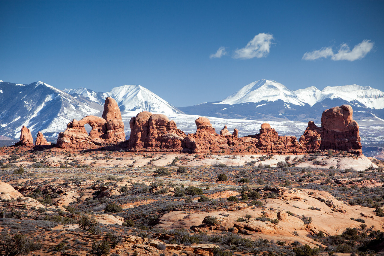 TURRET ARCH AND THE WINDOWS AREA OF ARCHES N.P.-FRAMED BY THE LA  SAL MOUNTAINS