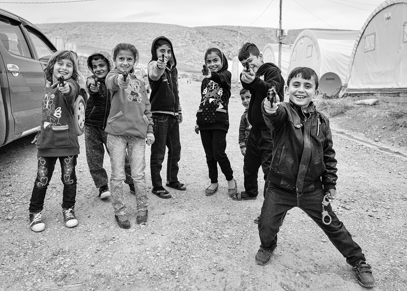 CHILDREN PLAYING IN THE CAMPS